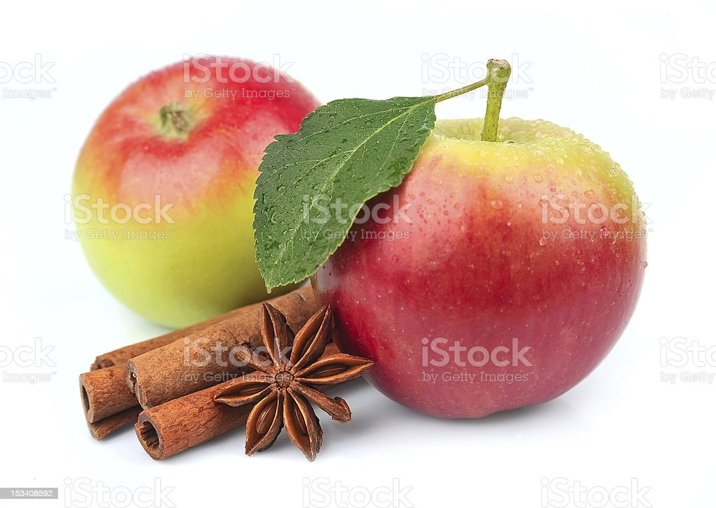 apple with cinnamon rods stock photo