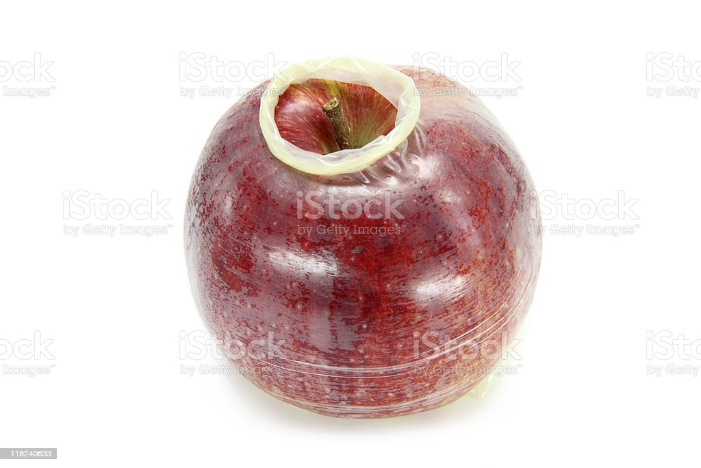 apple with condom royalty-free stock photo