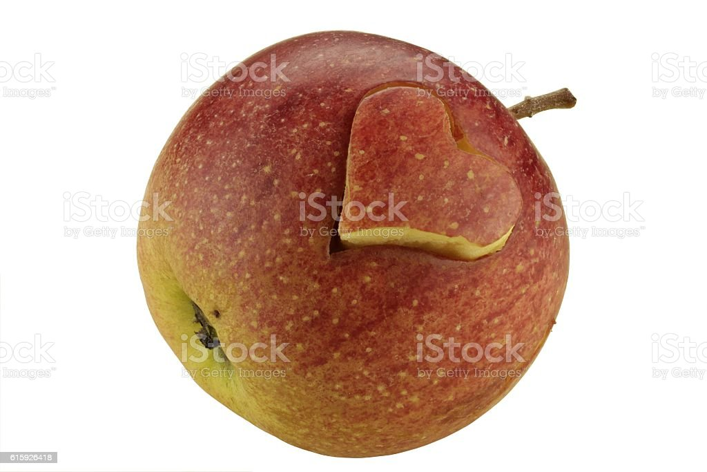 Apple with engraved heart - isolated stock photo