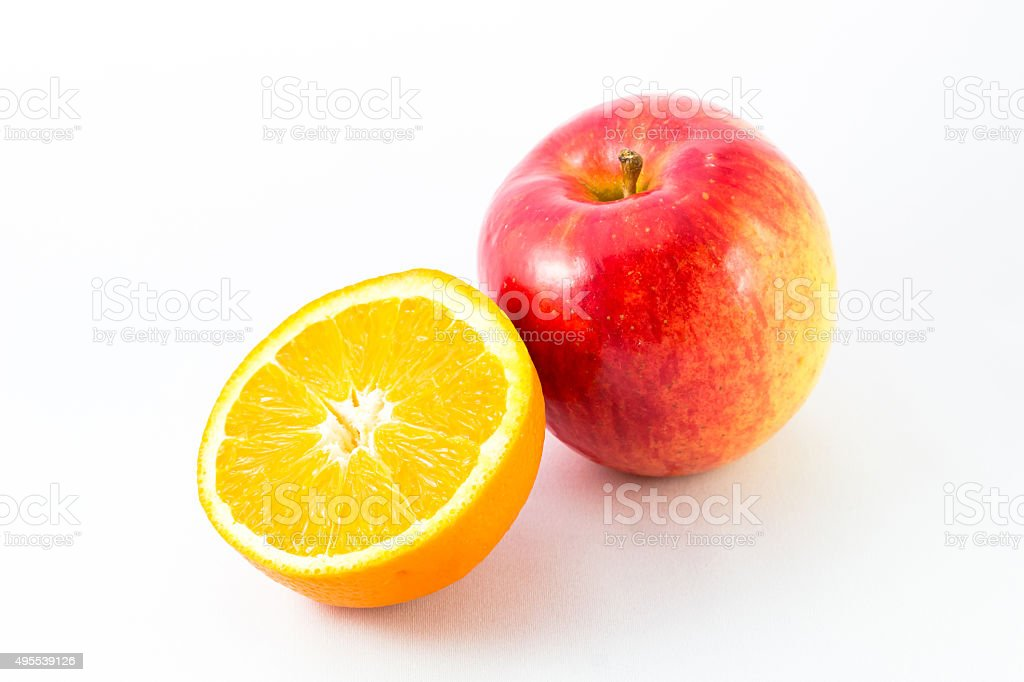 Apple with half orange. stock photo