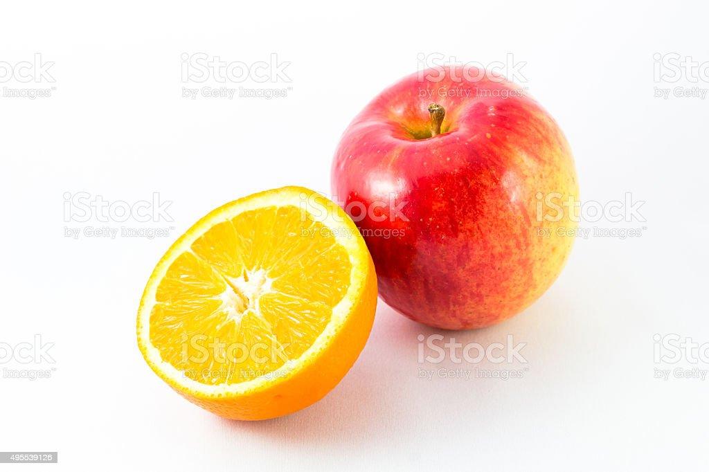 Apple with half orange. stock photo