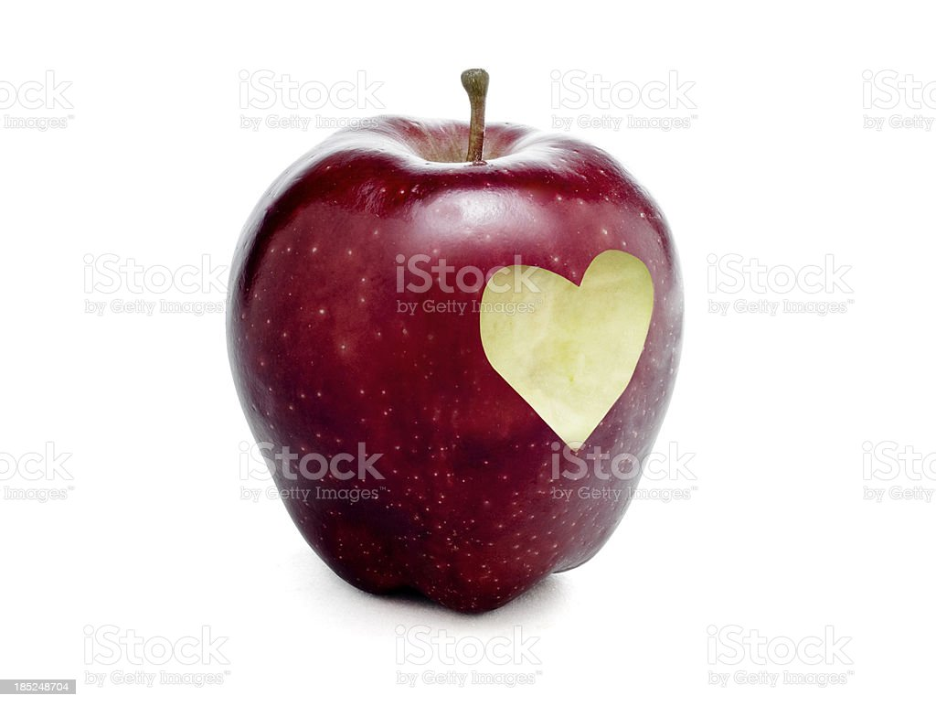 Apple with heart shape royalty-free stock photo