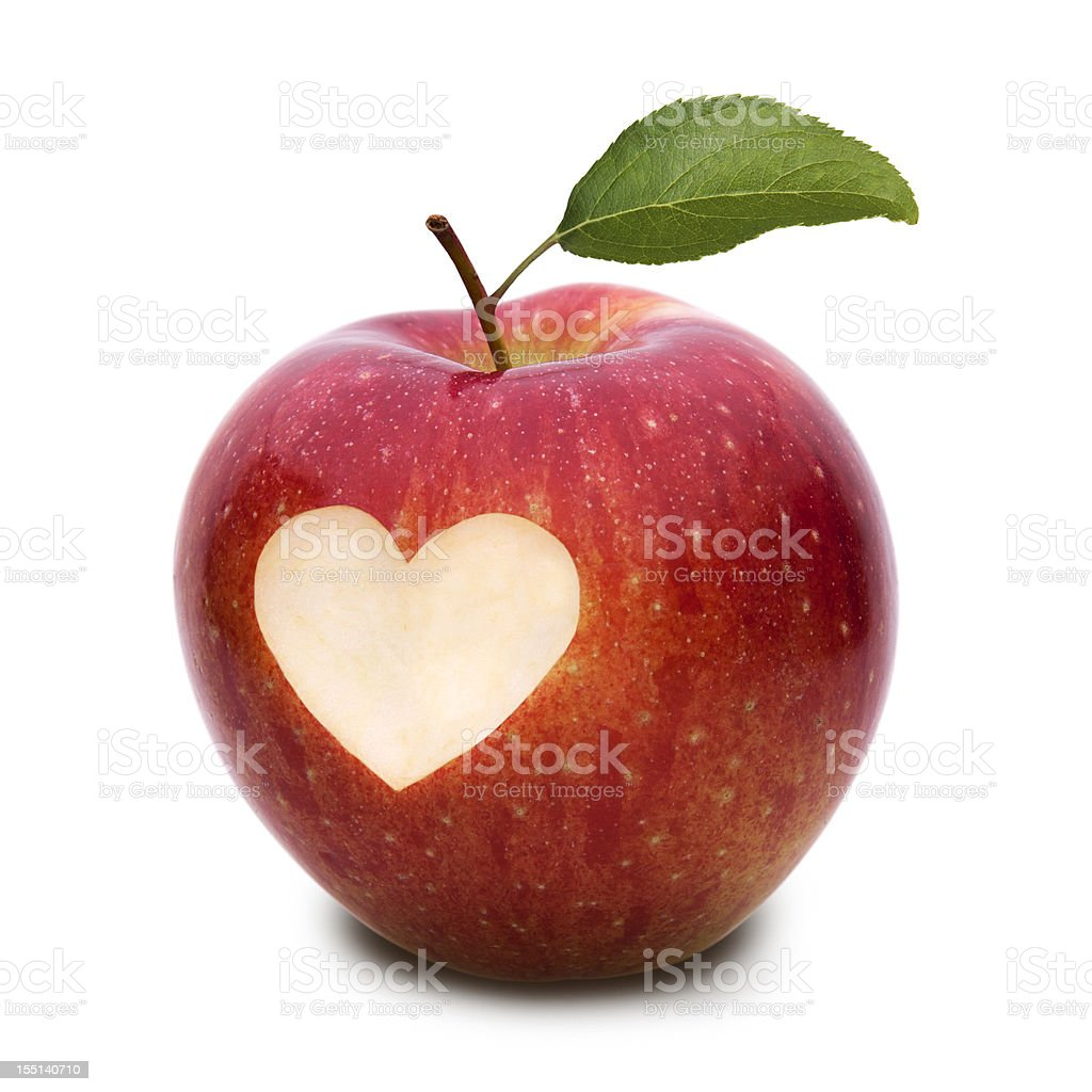 apple with heart symbol and leaf stock photo