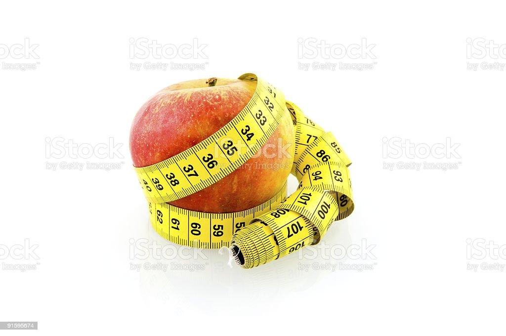 Apple avec ruban meassure photo libre de droits