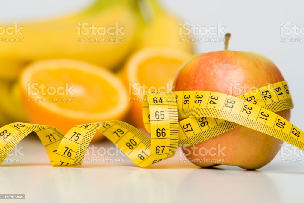 Apple with measuring tape royalty-free stock photo