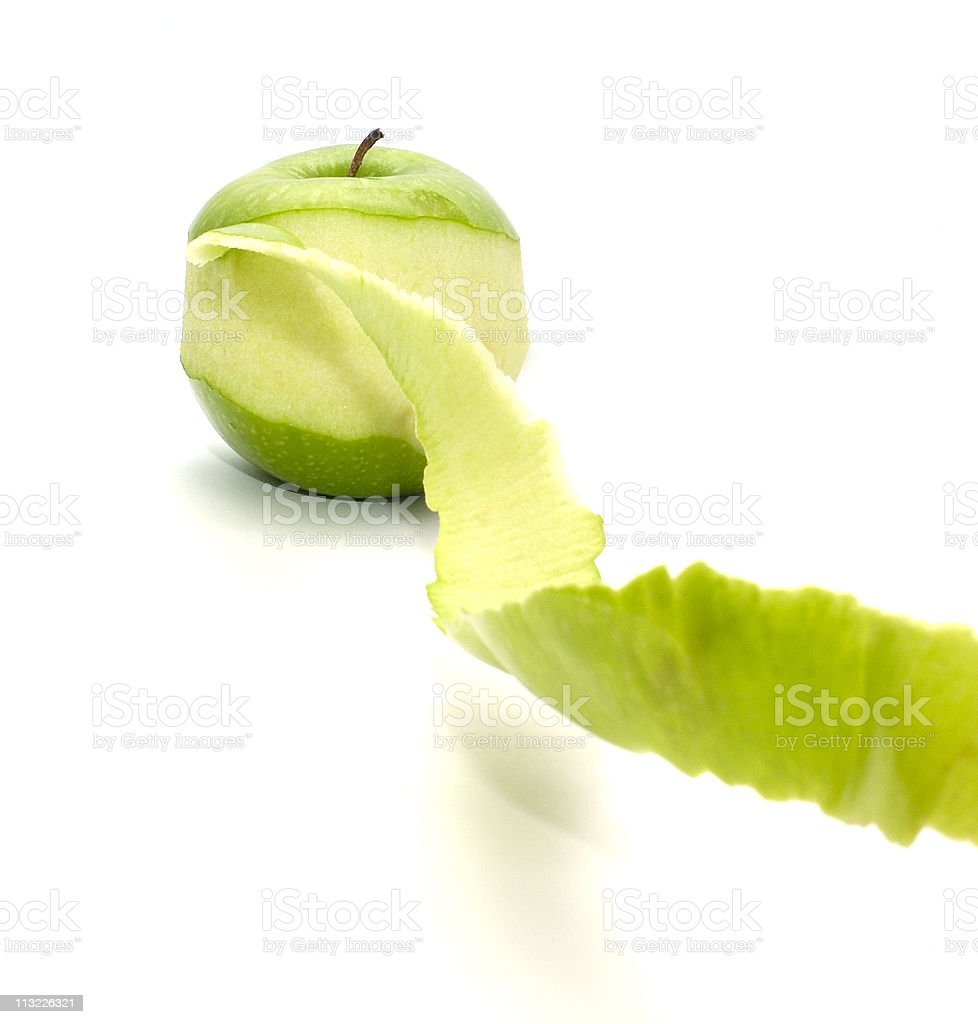 apple with peeled twisted skin royalty-free stock photo