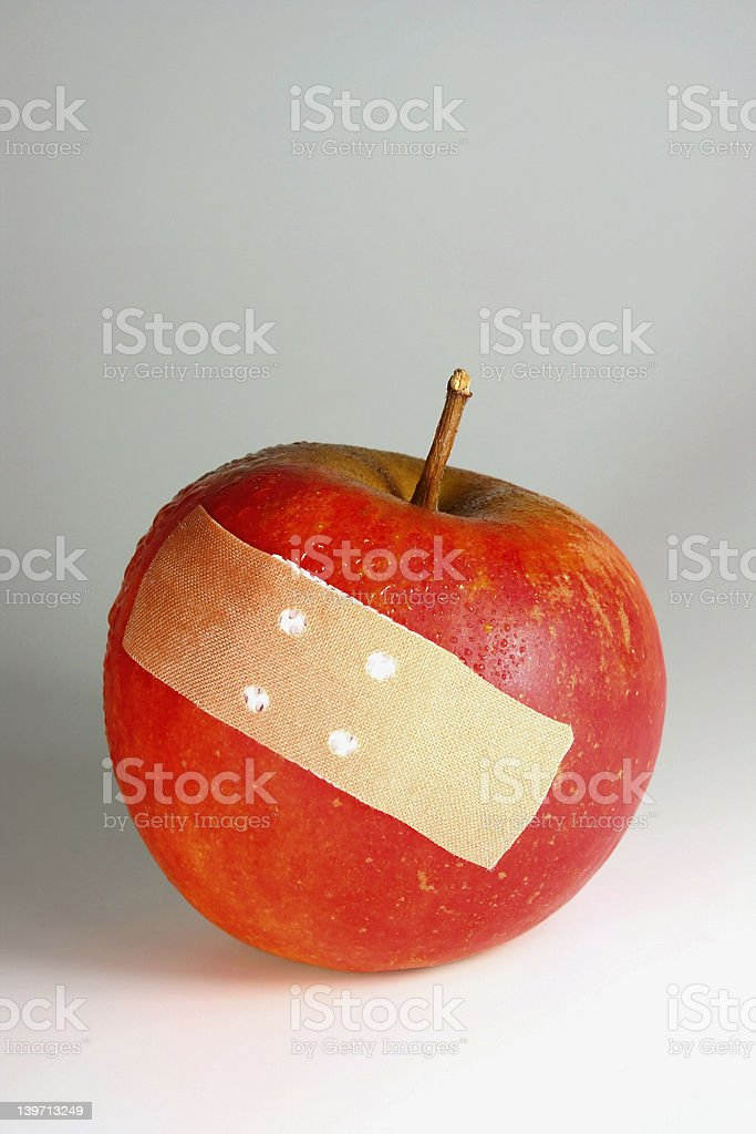 apple with plaster royalty-free stock photo