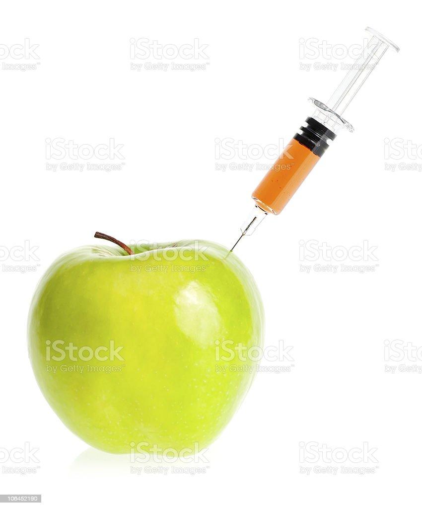 Apple with syringe royalty-free stock photo