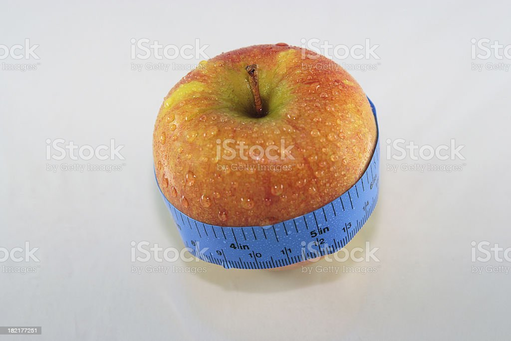 Apple with tape measure royalty-free stock photo