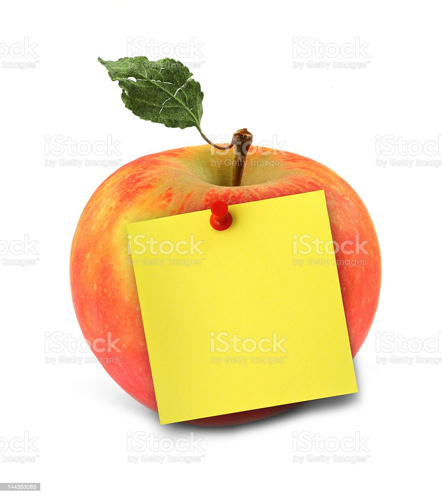 apple with yellow note stock photo