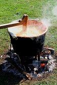 Applebutter kettle over open fire