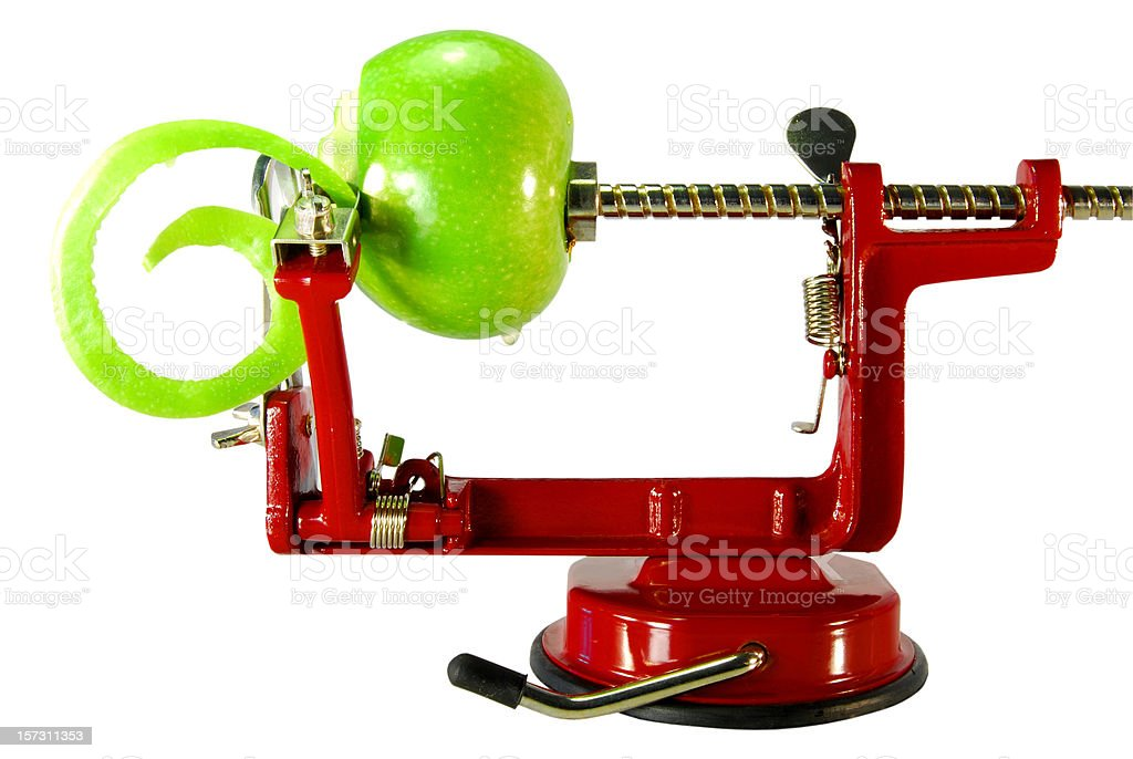 Appler peeler with a green apple stock photo