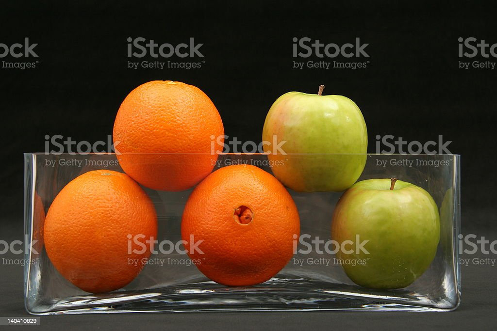 Apples and Oranges on Black royalty-free stock photo