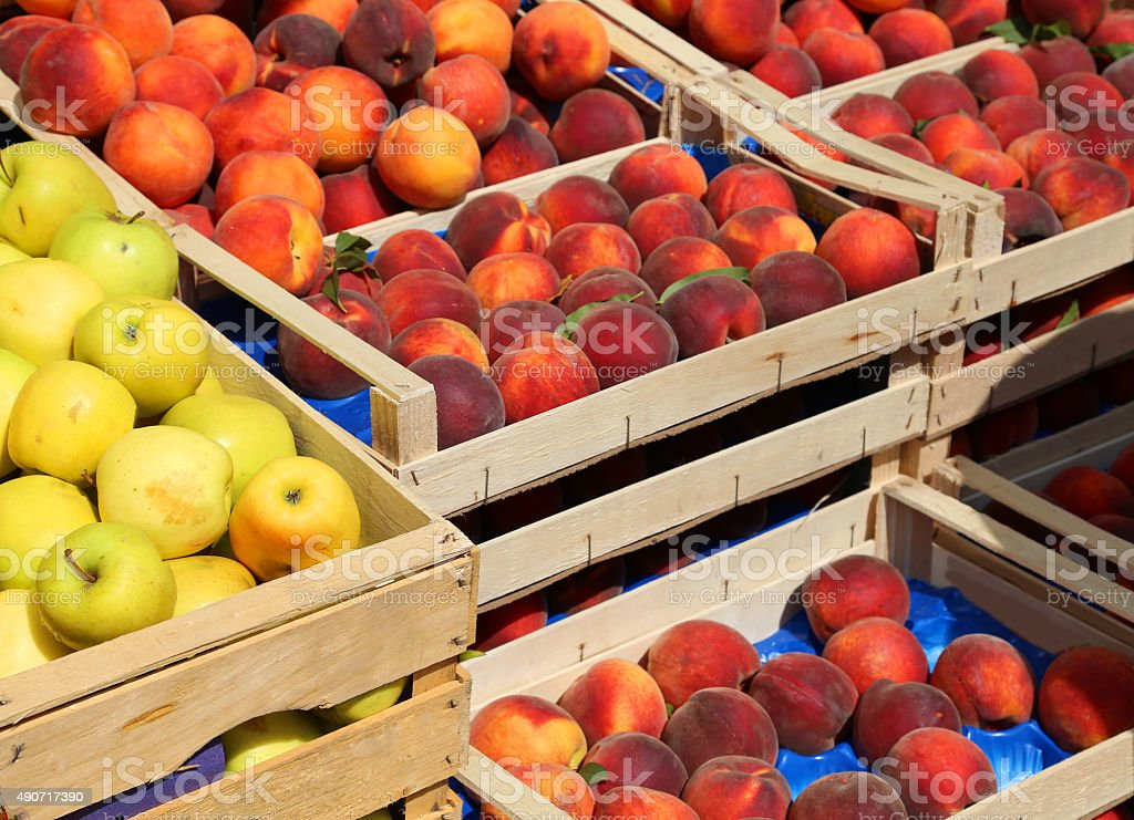 apples and peaches for sale at market fruit in summer stock photo