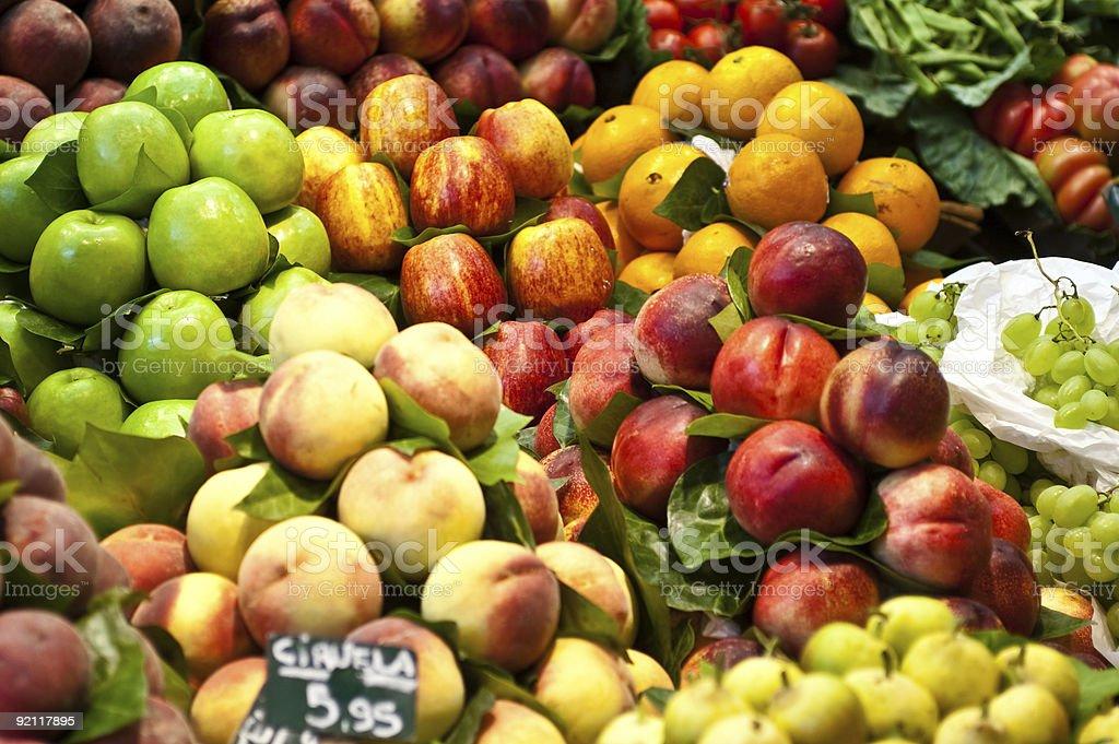 Apples and peaches in the la Boqueria marketplace royalty-free stock photo