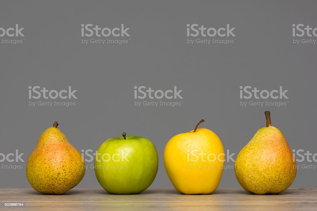 Apples and pears on wooden table stock photo