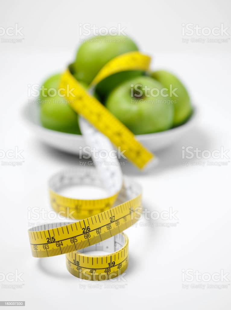 Apples and Tape Measure in a Bowl stock photo
