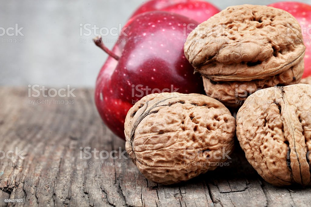 Apples and walnuts stock photo