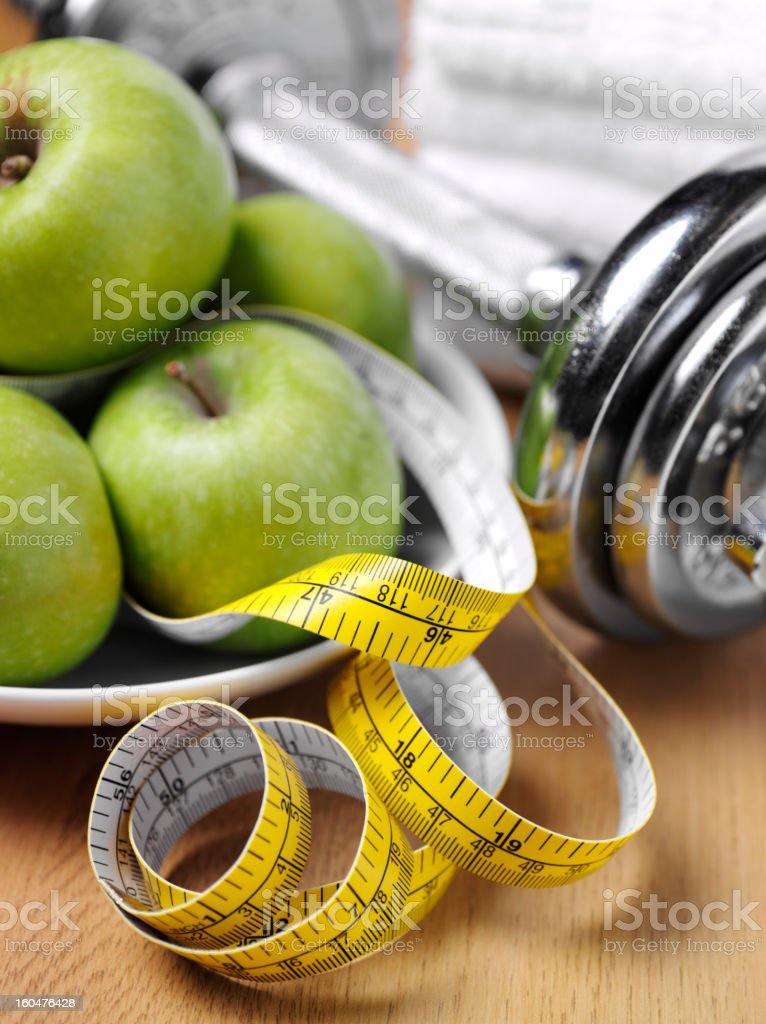 Apples and Weights for a Healthy Lifestyle stock photo