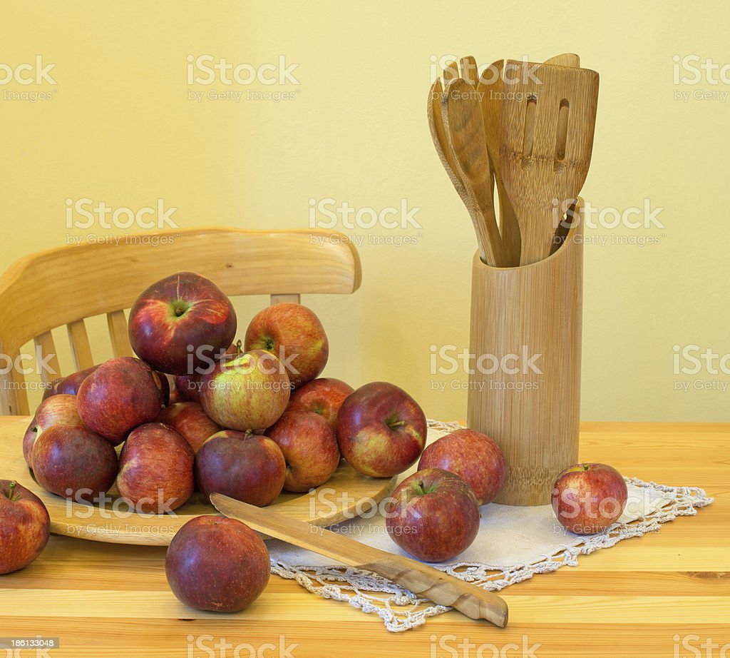 Apples and wooden utensils royalty-free stock photo