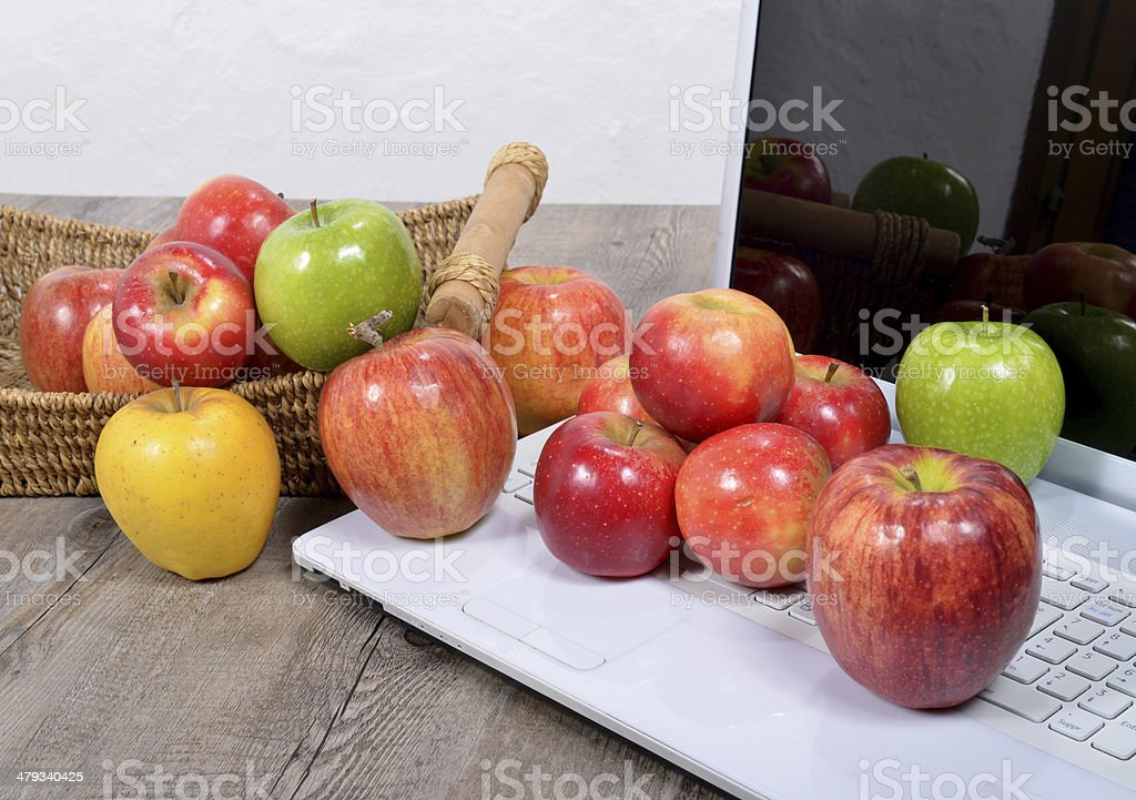 apples fell on the keyboard of a computer stock photo