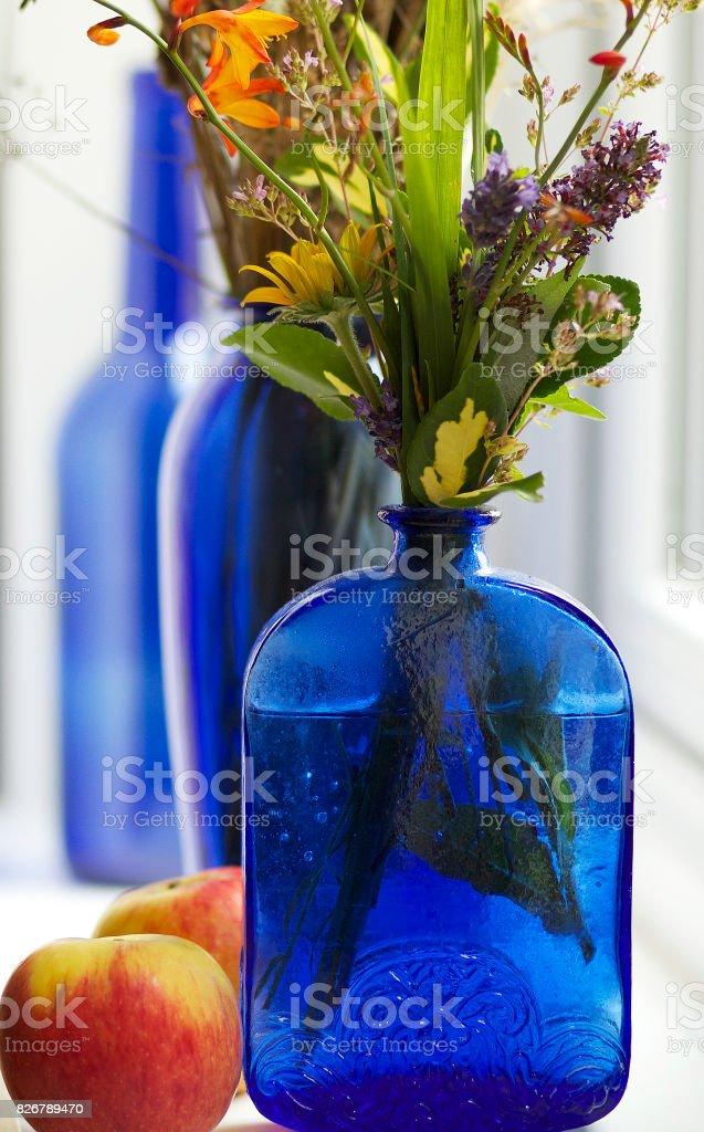 Apples & Fresh Flowers stock photo