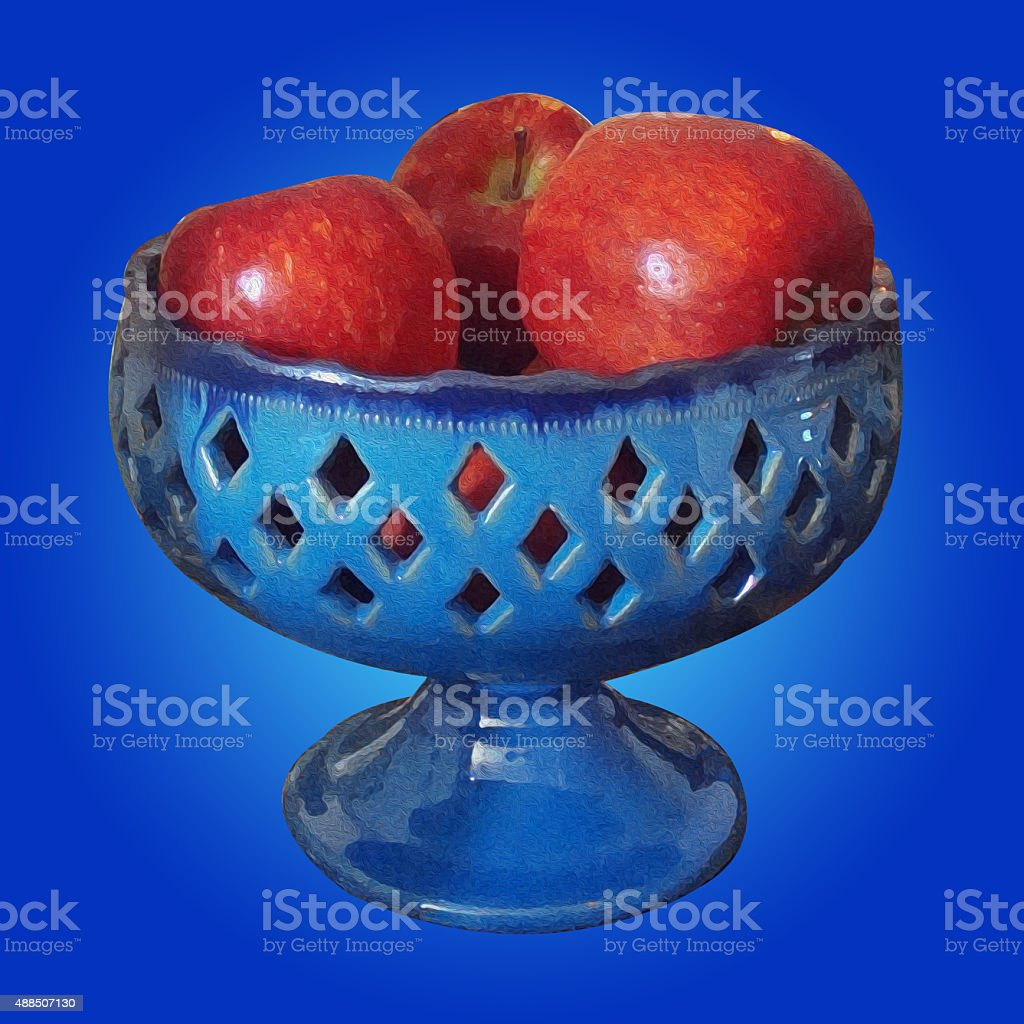 apples in blue pottery dish stock photo