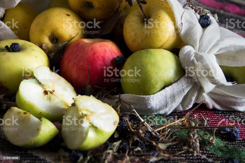 Apples in white towel on follore national balkan carpet. stock photo