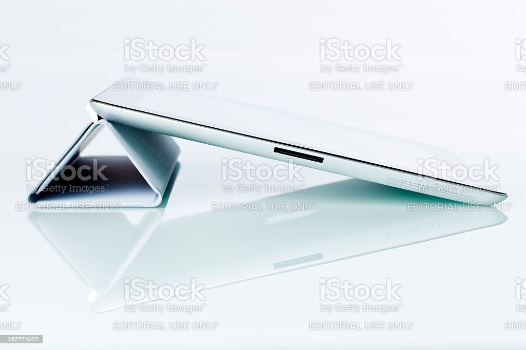 Apple's iPad2, isolated, with Smart cover royalty-free stock photo