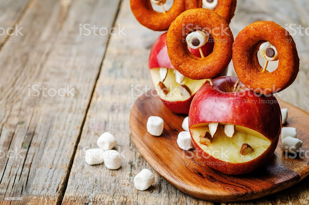apples, marshmallows and donuts stock photo