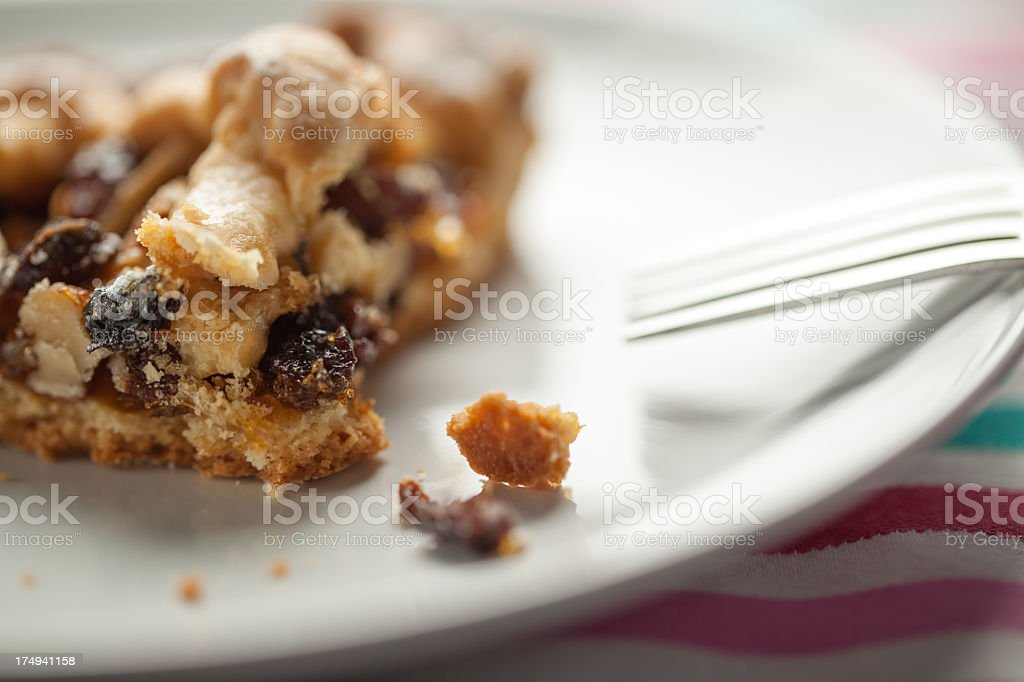 Apples, Nuts and Raisins Tart with Fork royalty-free stock photo