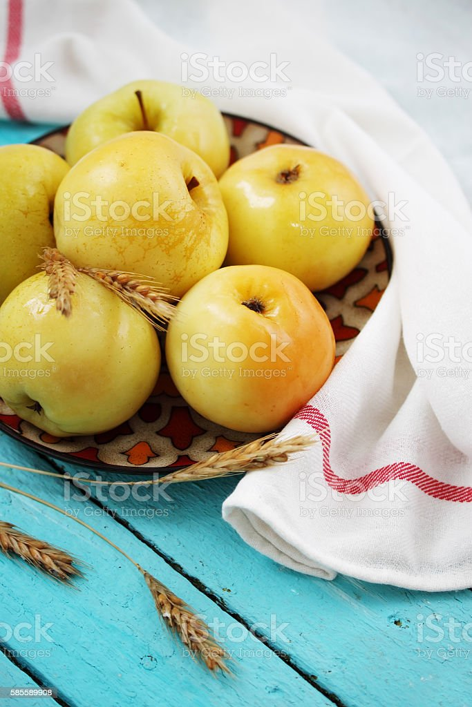 apples on a blue board stock photo