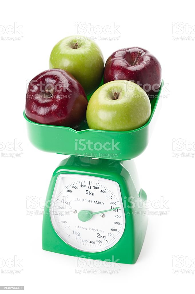 apples on a kitchen food scale stock photo