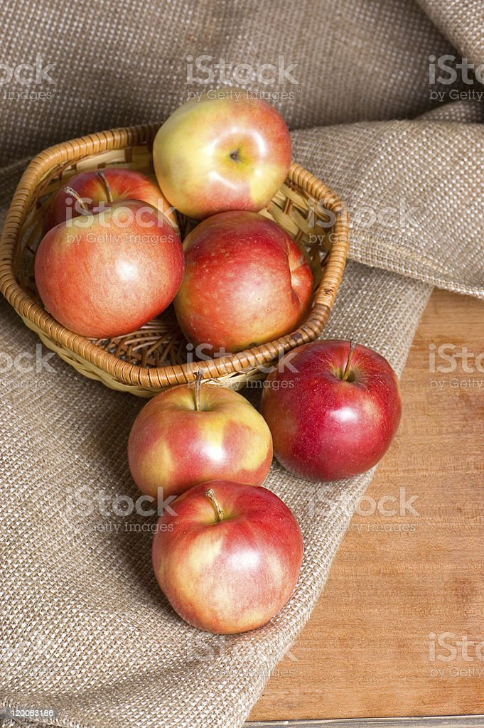 Apples on a sacking in  wooden table royalty-free stock photo