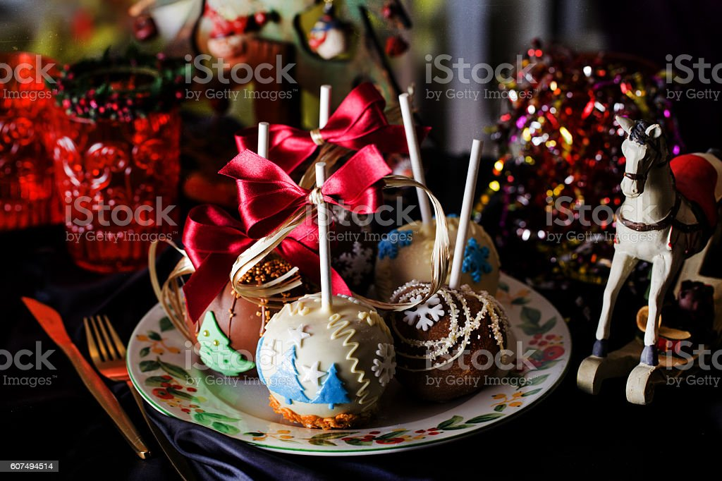 apples on a stick in the new year stock photo
