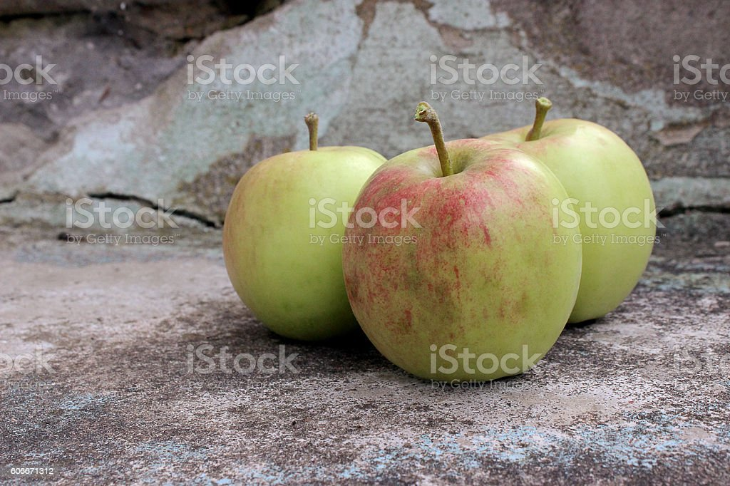 Apples on a stone stair stock photo