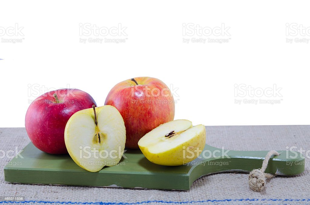 Apples on a vintage cutting board royalty-free stock photo