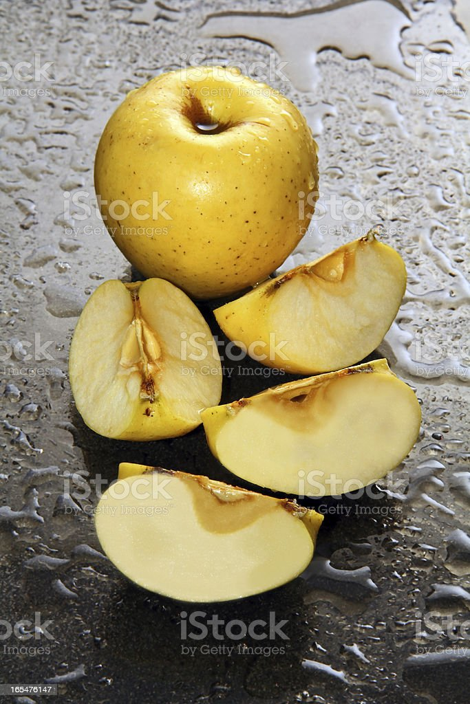 Apples on a wet glass. royalty-free stock photo
