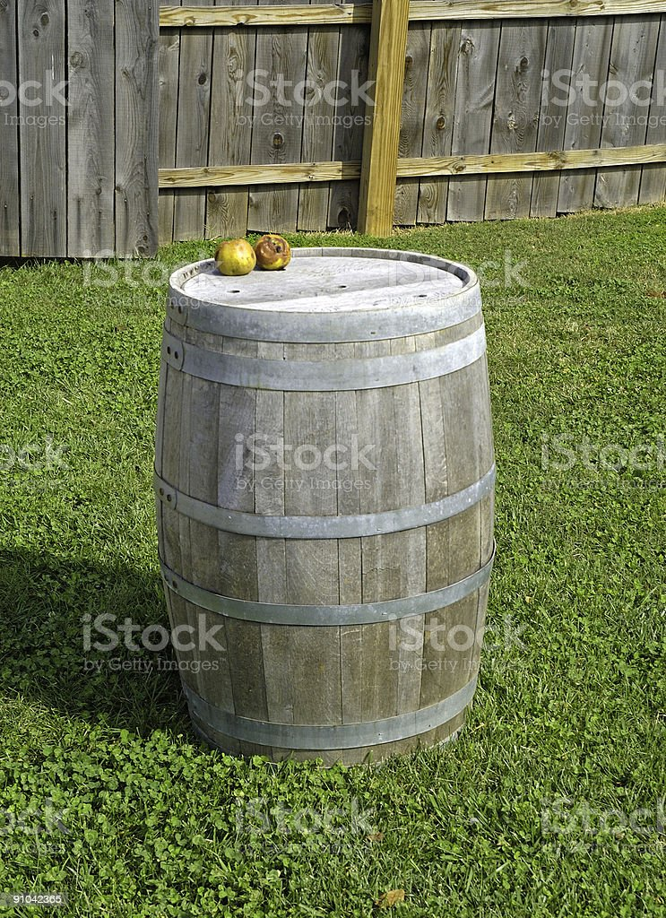 apples on an old wooden barrel royalty-free stock photo