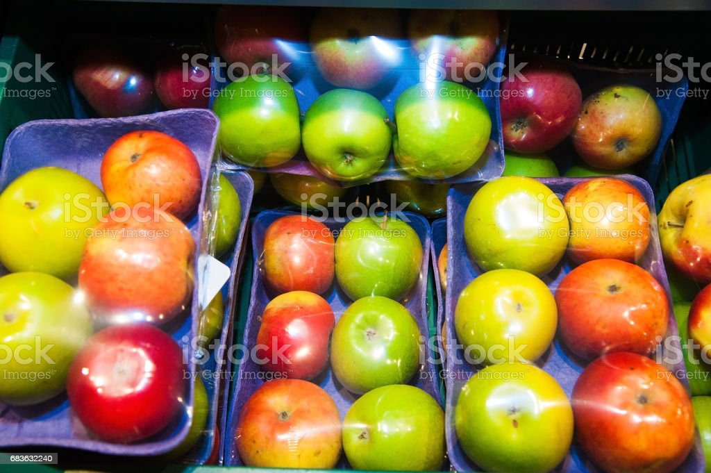 Apples on boxes in supermarket stock photo