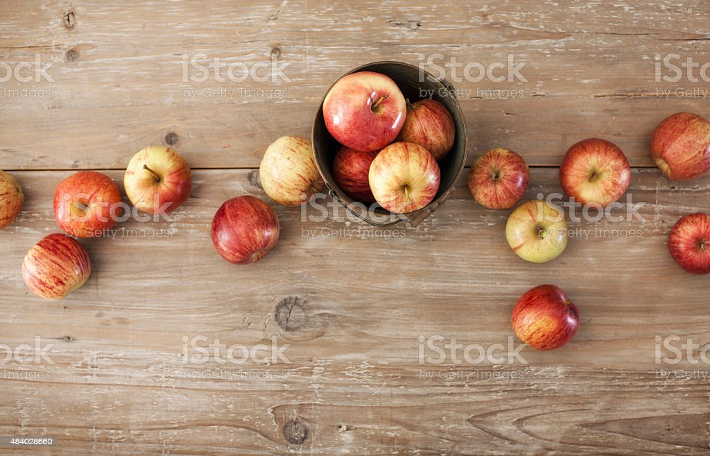 Apples on Old Rustic Wood Background stock photo