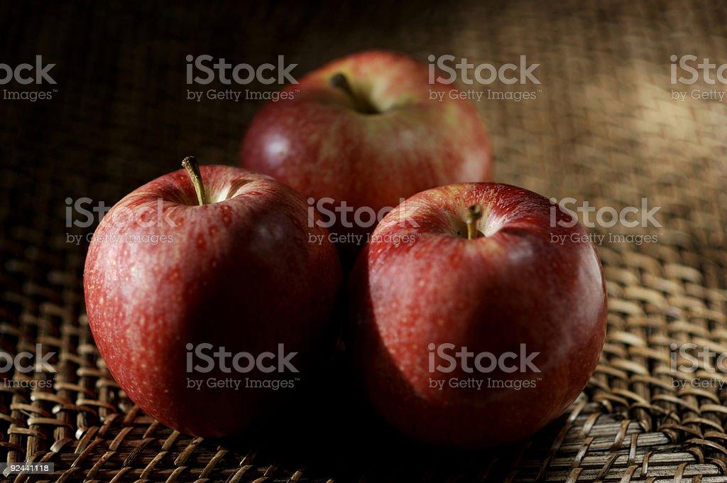 apples on rustic matt, natural light, shallow focus stock photo