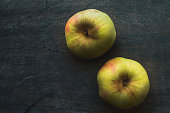Apples on the dark scratched background horizontal