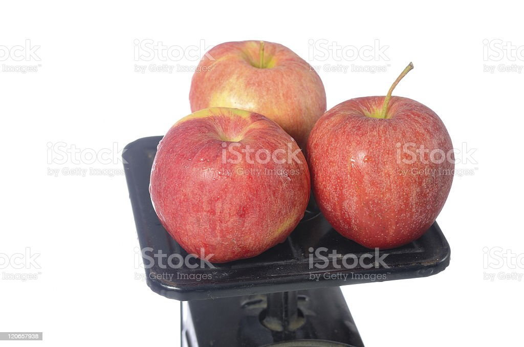 Apples on Vintage Scale stock photo
