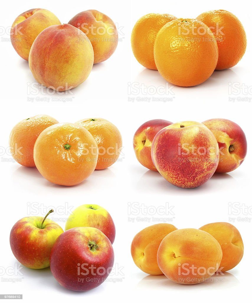 Apples, oranges, and other fruits clustered on white royalty-free stock photo