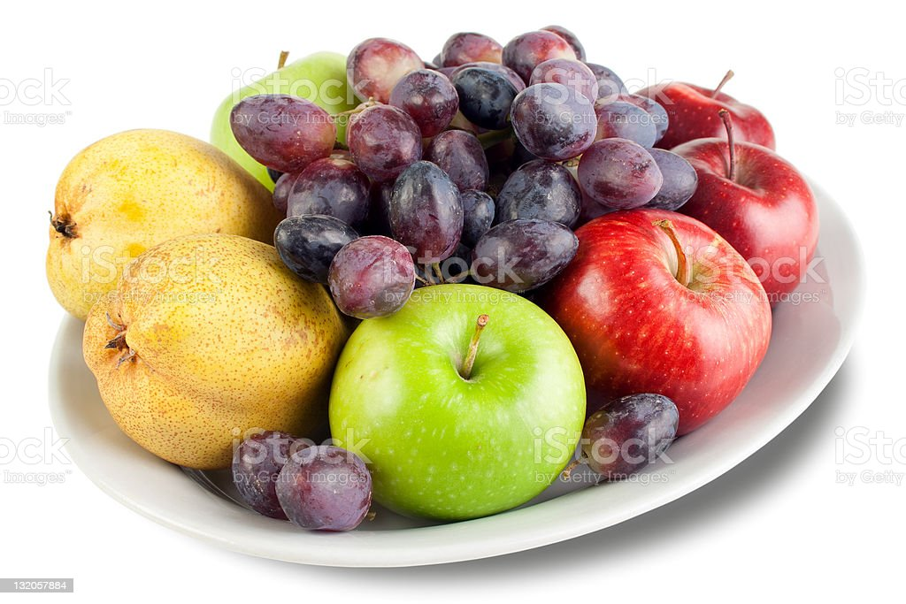 Apples, pears and grapes on the plate royalty-free stock photo