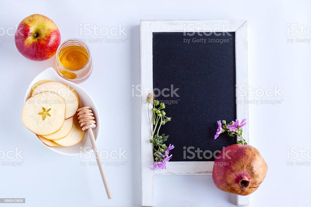 Apples, pomegranate and honey for Rosh Hashanah stock photo