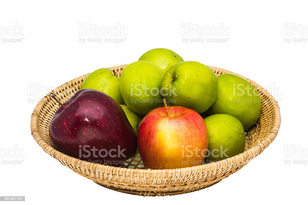 Apples sitting in a wooden basket isolated on white background. stock photo