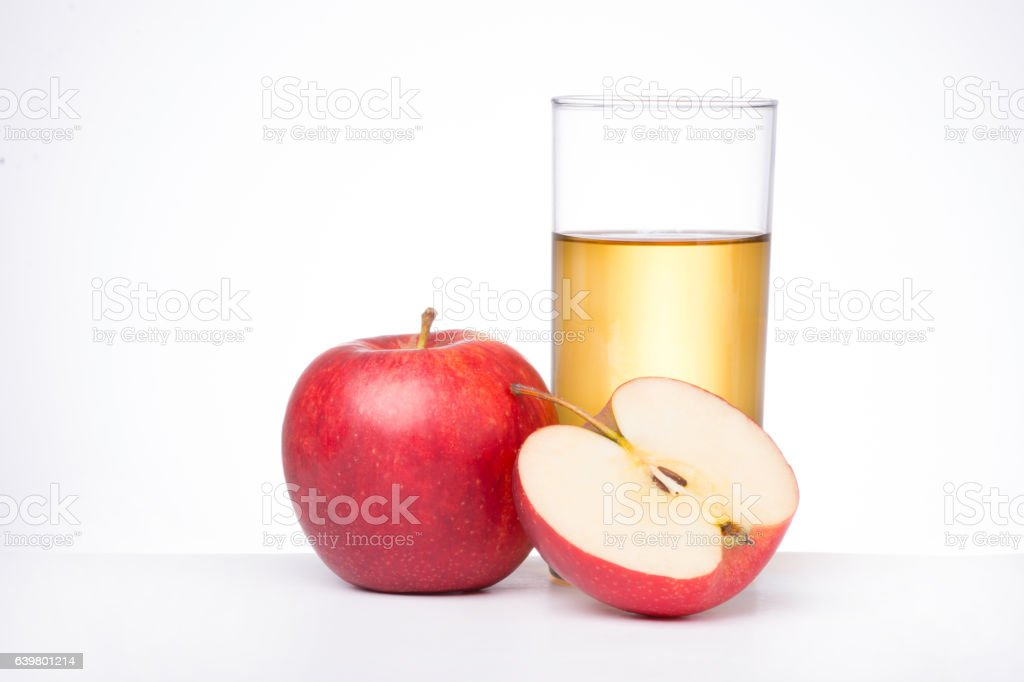 Apples with glass of juice on white background stock photo