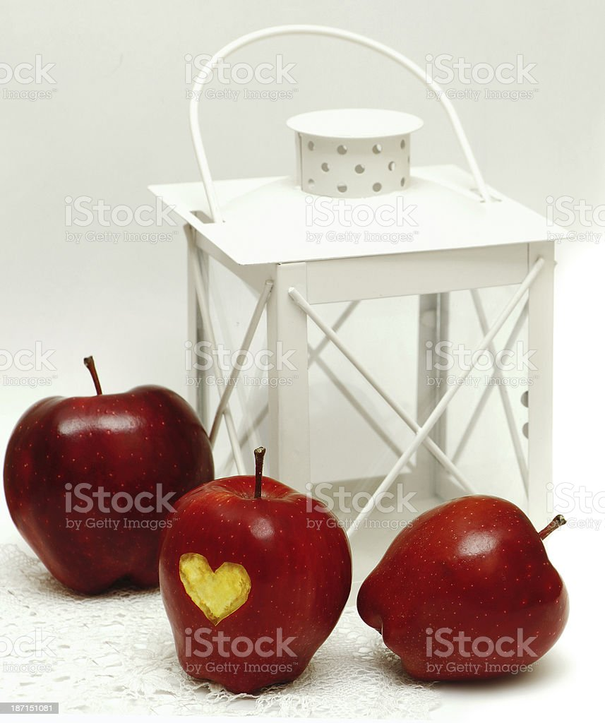 apples with heart and lantern isolated on white background stock photo